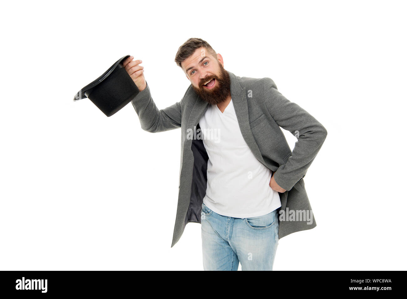 Man bearded guy magician. Magic trick performance concept. Circus magic trick performance. Entertainment and theatre. Magic show. Master of cunning tricks. Time traveller. Street performance. Stock Photo