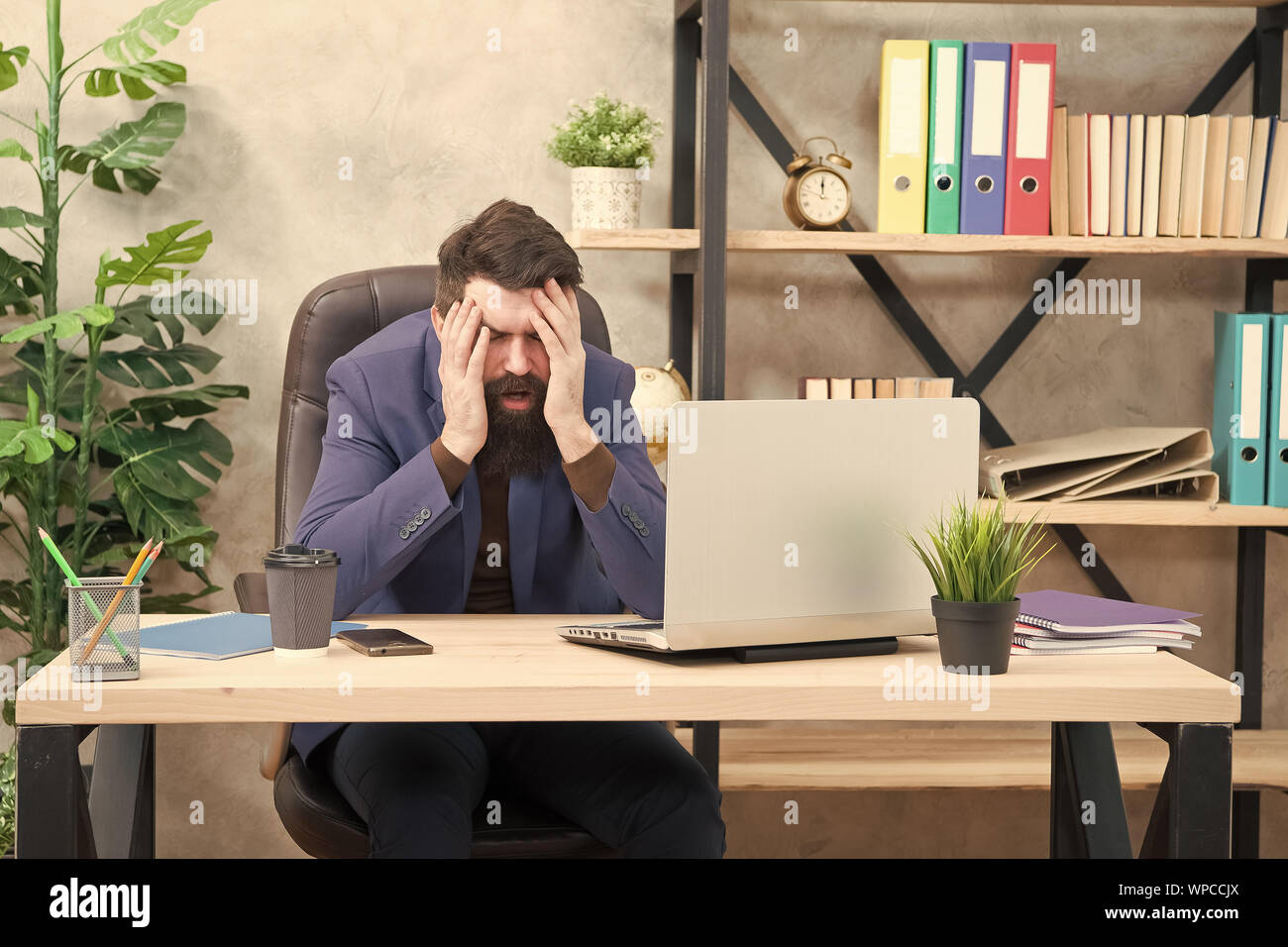 Unforgivable mistake. Falling stock prices. Man bearded boss sit office with laptop. Manager solving business problems online. Business man failed. Risky business. Broker and financial indicators. Stock Photo