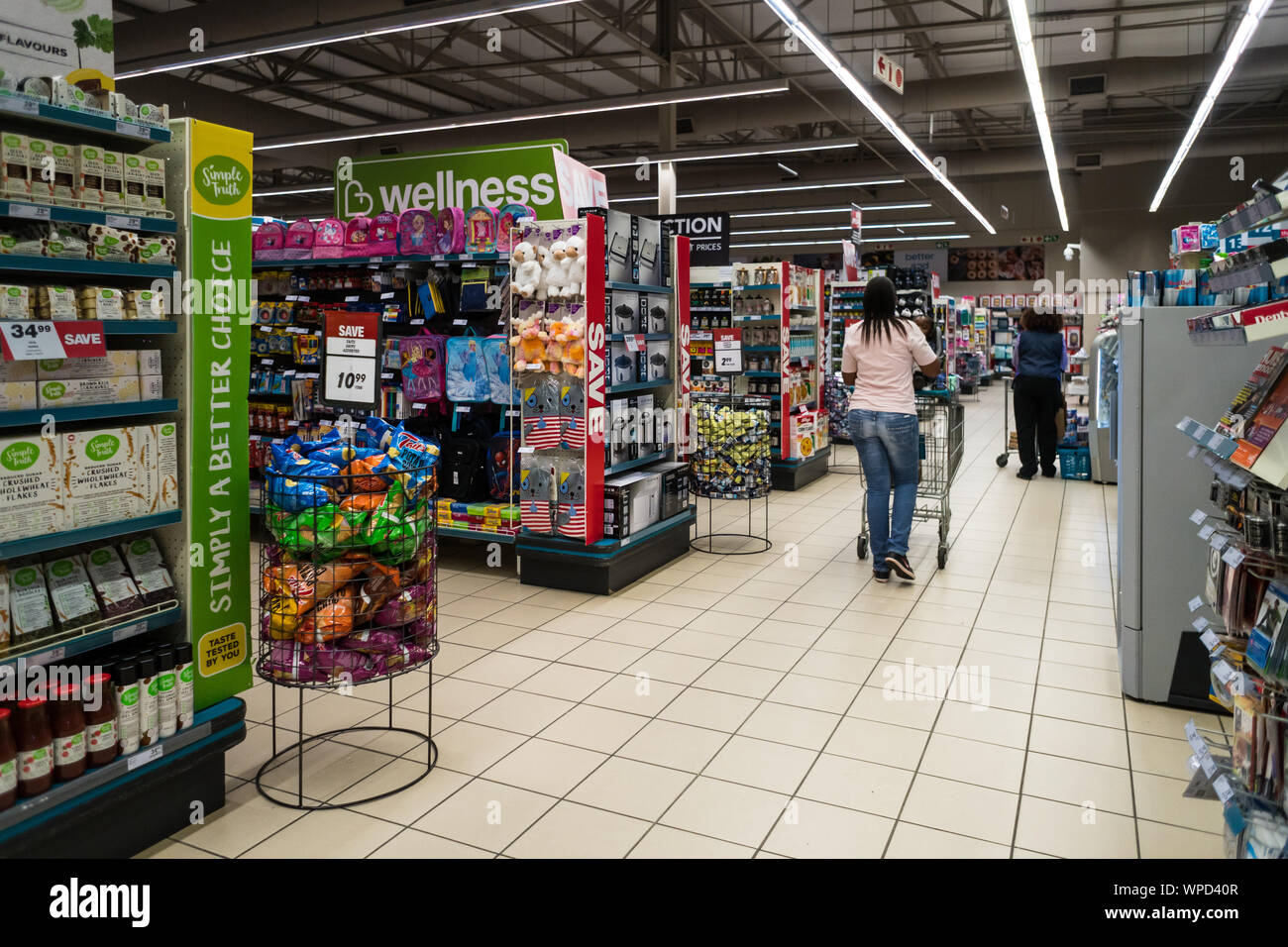 interior of a supermarket or store in Mpumalanga, South Africa with shoppers and aisles filled with products or items for sale Stock Photo
