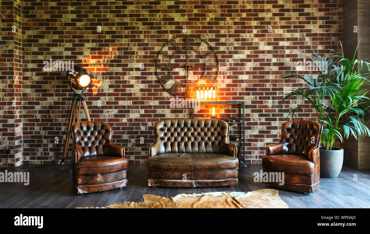 bachelor pad, exposed brick fireplace, chesterfield sofa, dark brown sofa, decorating ideas, mid century Stock Photo