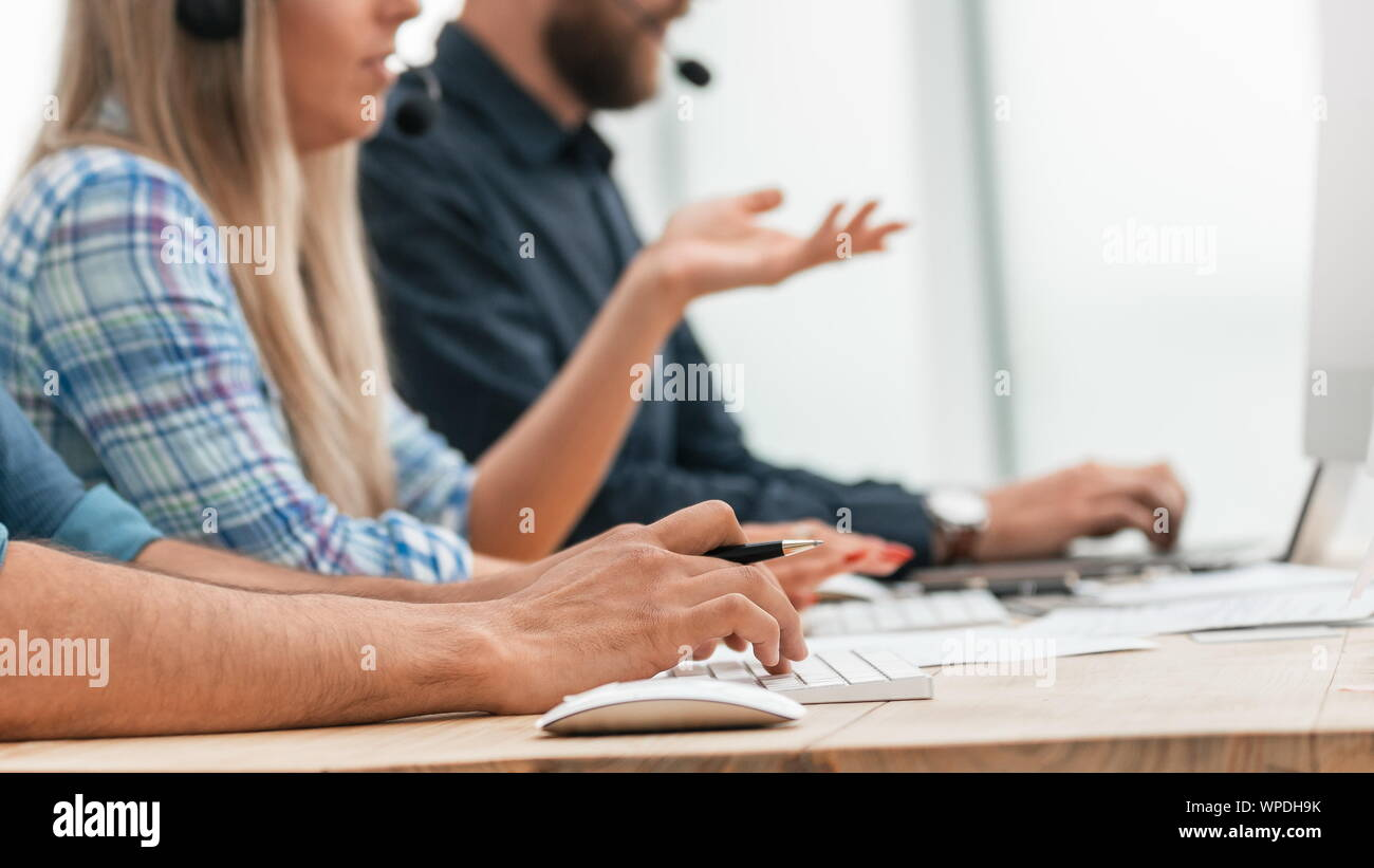 close up. call center operators in the workplace. Stock Photo
