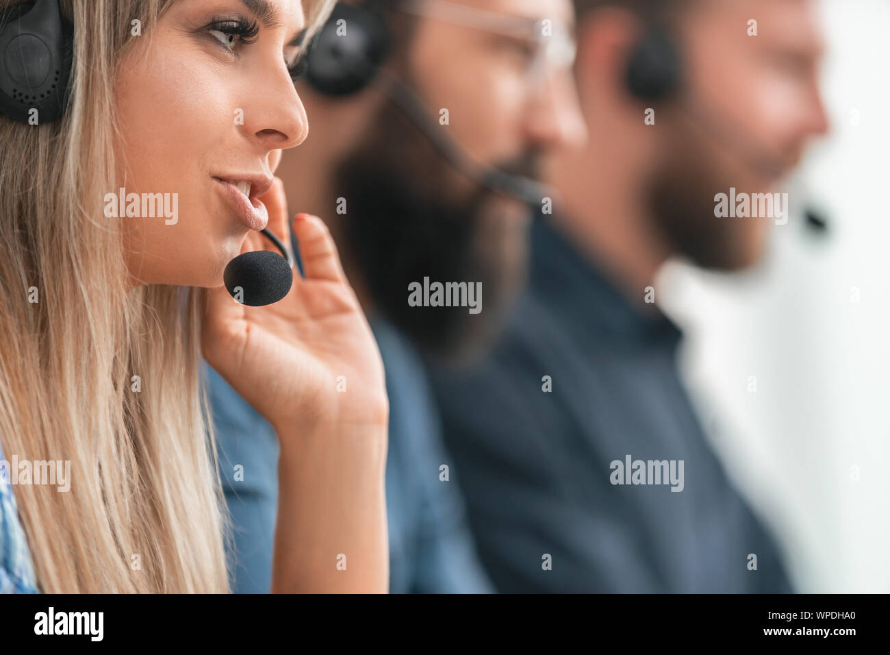 close up. background image of call center employees Stock Photo