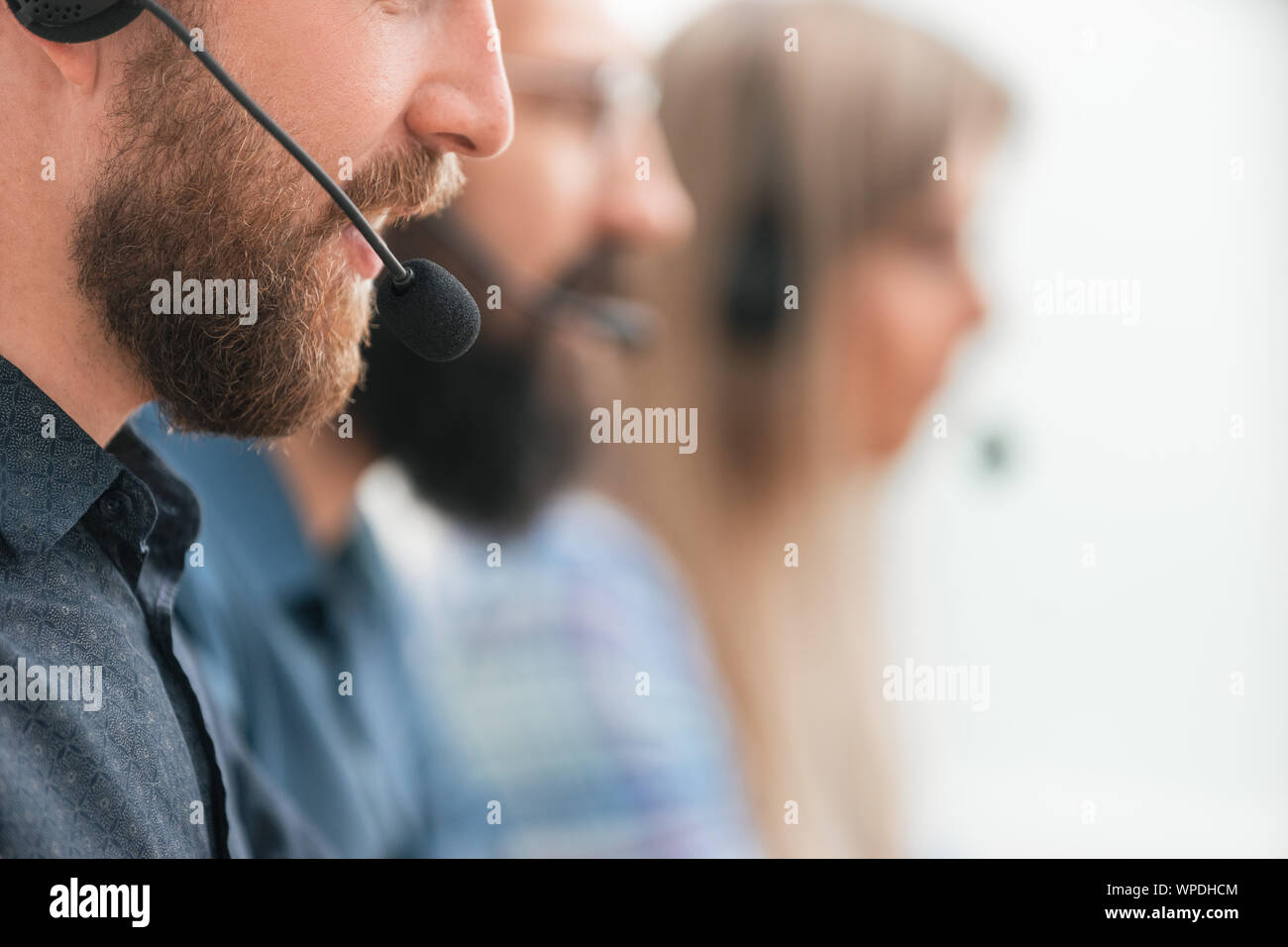 close up. professional call center employee in the workplace. Stock Photo