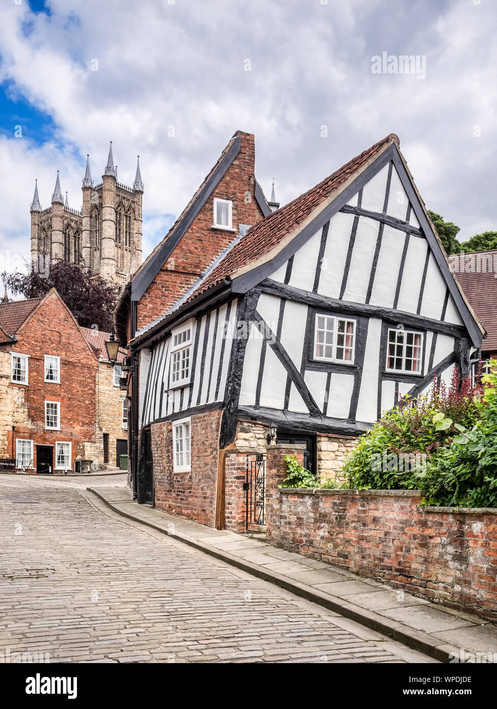 2 July 2019: Lincoln, Lincolnshire, UK - Crooked half-timbered house in Michaelgate, Lincoln. Stock Photo