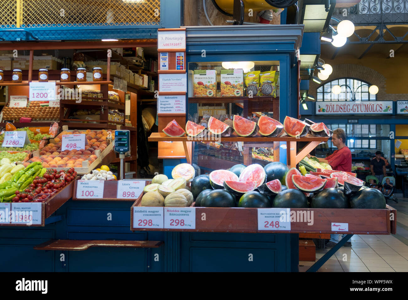Budapest, Hungary - Aug 16, 2019: Colourful fruit stall with melons and fruits in the covered Central Market Hall in Budapest, Hungary Stock Photo
