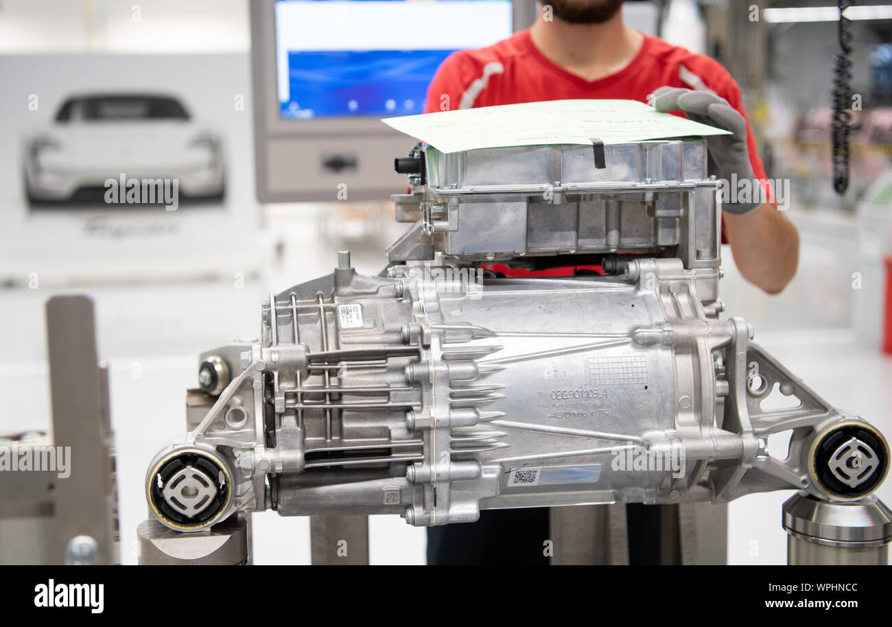 09 September 2019 Baden Wuerttemberg Stuttgart An Employee Is Working On An Electric Motor During A Show Production To Open The Production Of The Porsche Taycan The Sports Car Manufacturer S First All Electric Model
