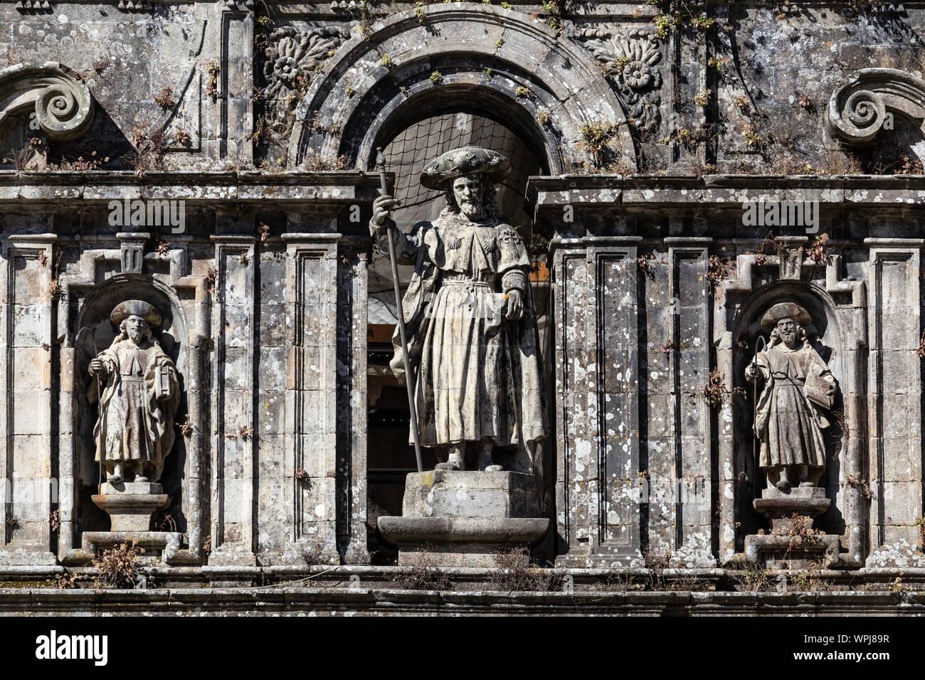 Sculpture of the Apostle Santiago and his disciples. East facade of Santiago de Compostela cathedral Stock Photo