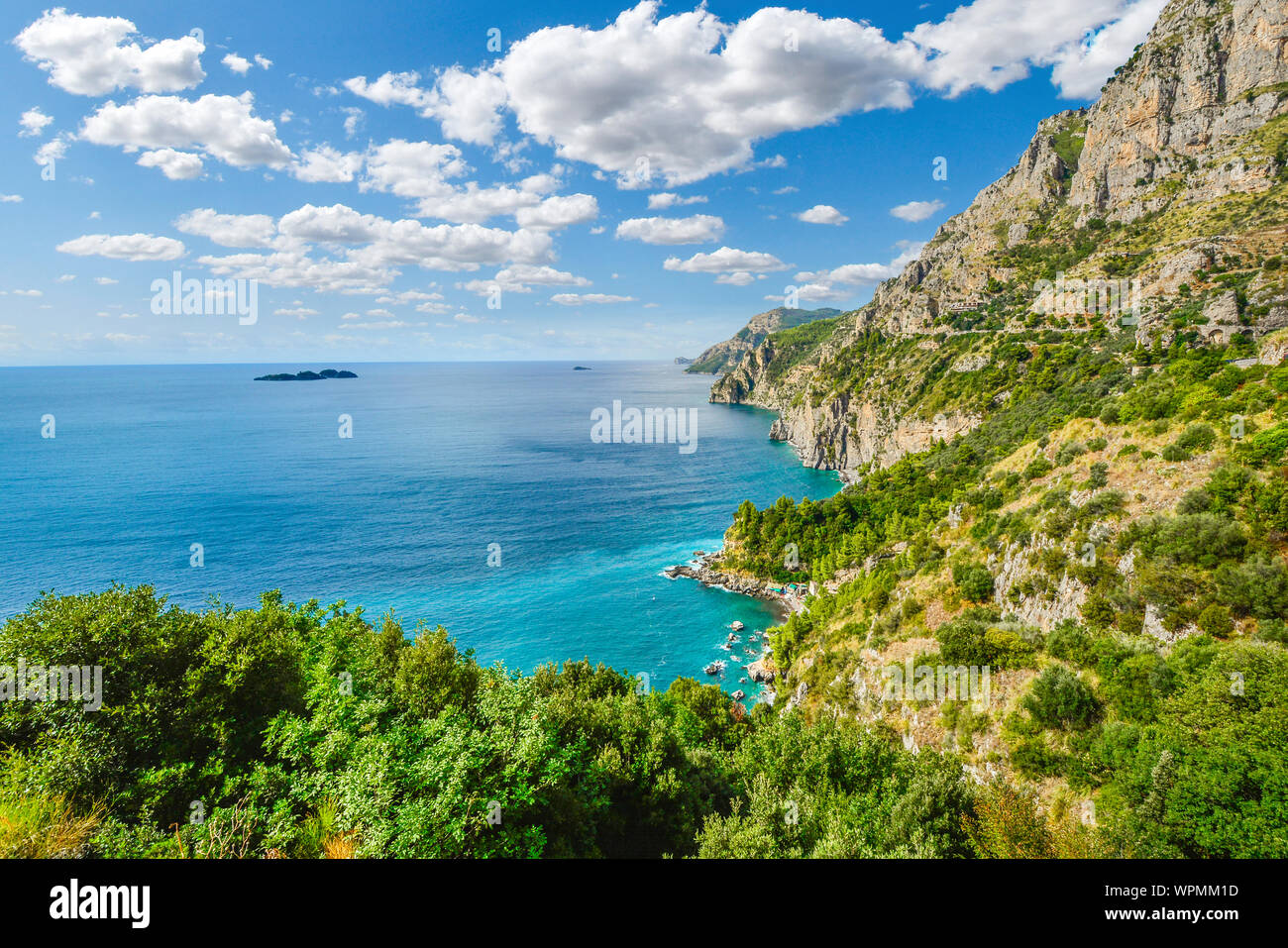 A view from the famous Amalfi Coast drive road towards the cliffs, mountains, coastline, beaches and Mediterranean Sea near the town of Sorrento Italy Stock Photo
