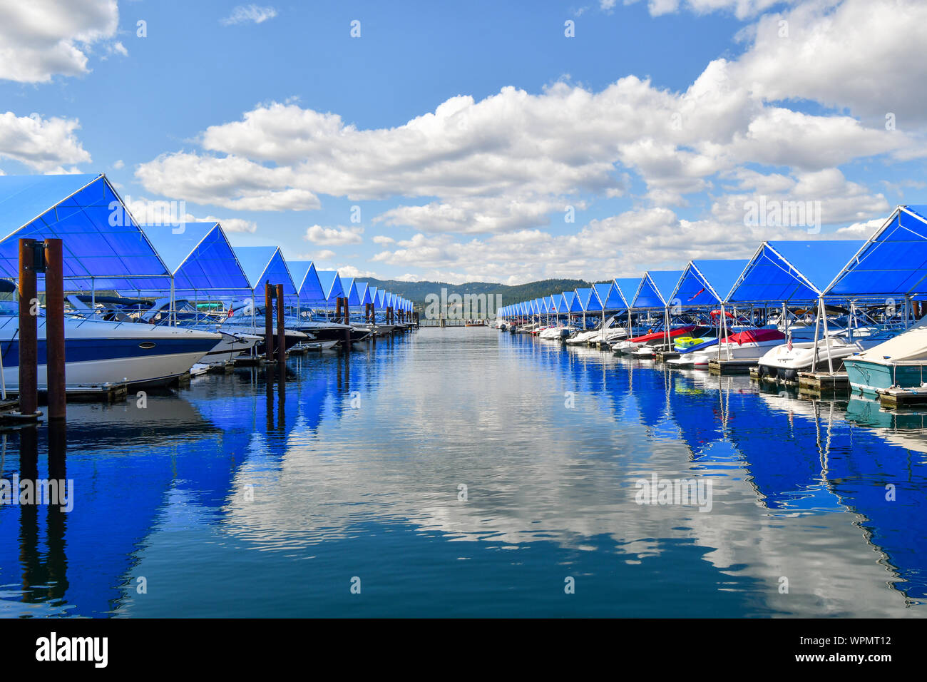 Boats line up in boat slips at the floating boardwalk marina at the Coeur d'Alene Resort in Coeur d'Alene, Idaho. Stock Photo