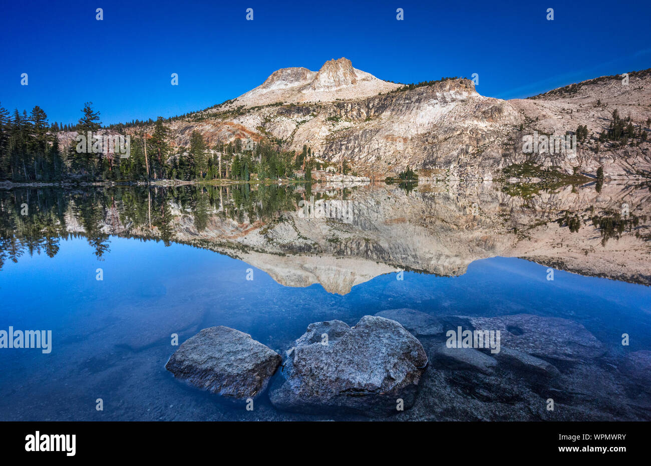 Scenic View Of Lake Against Blue Sky Stock Photo