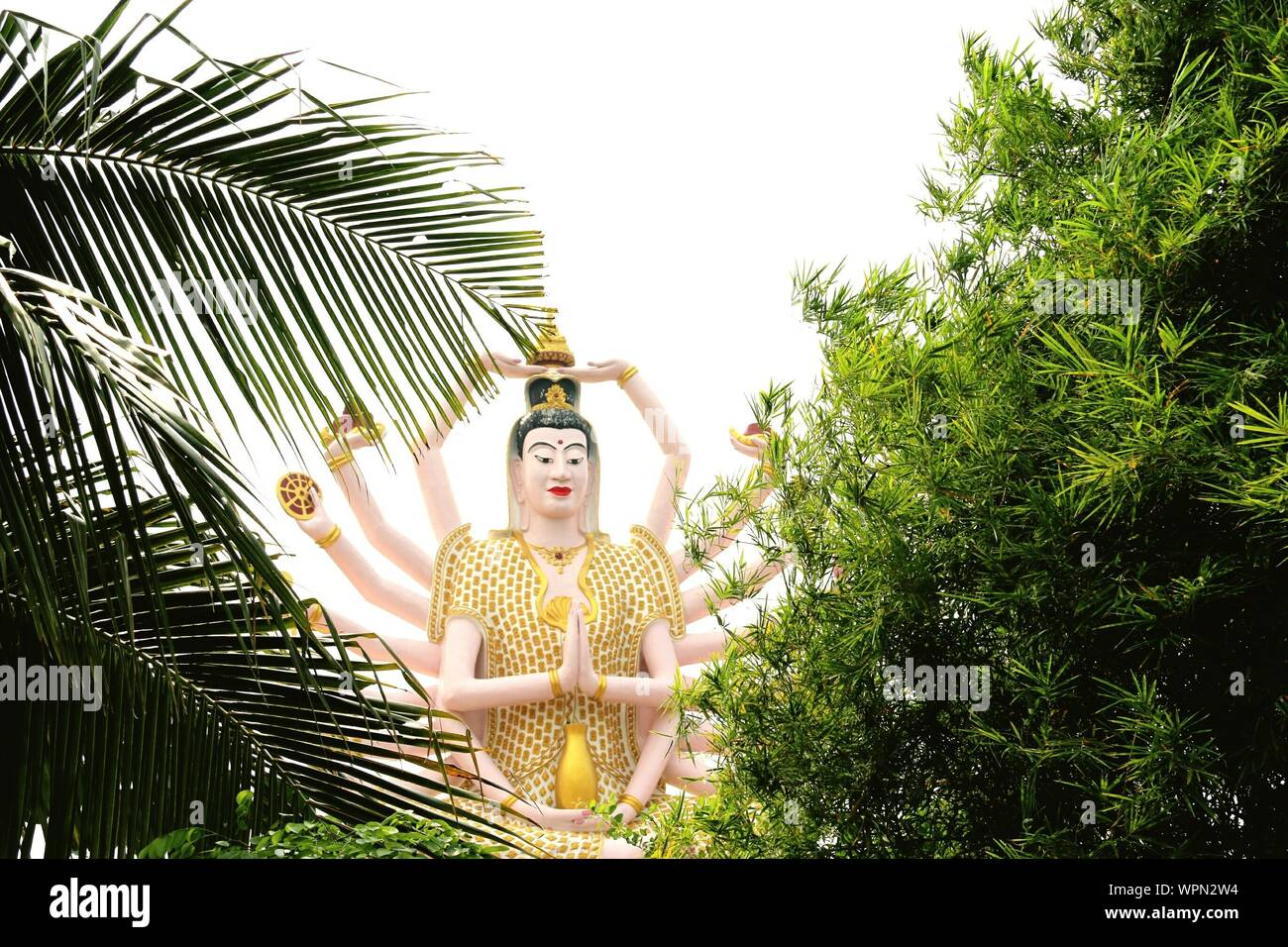 Low Angle View Of Guanyin Statue At Wat Plai Laem Temple Stock Photo