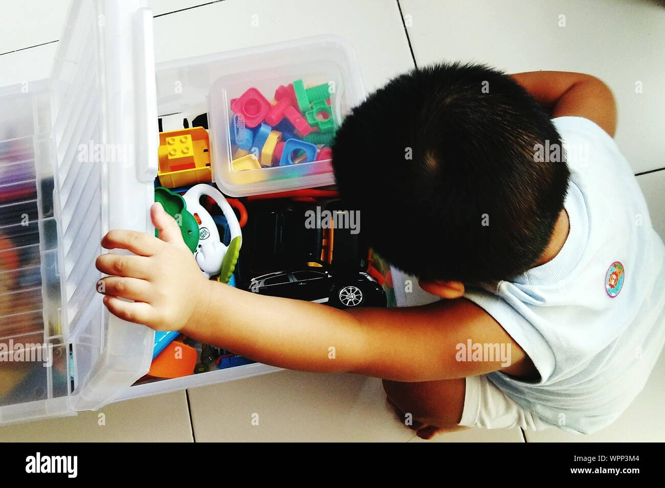 High Angle View Of Boy With Toys - Stock Photo