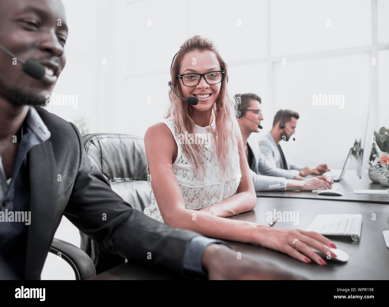 young business woman sitting at table in call center. photo with copy space Stock Photo