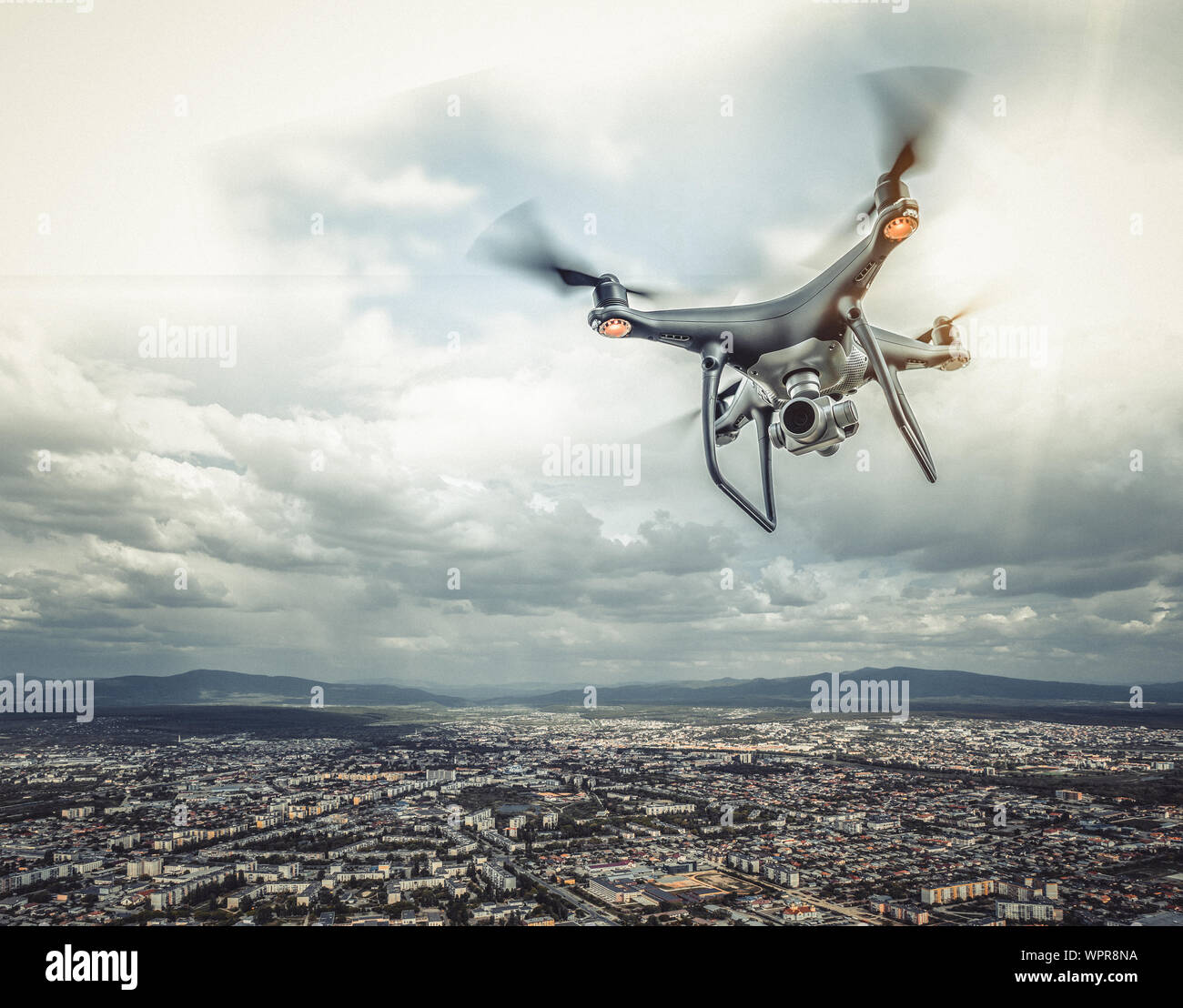 The drone is flying over the city. Stock Photo
