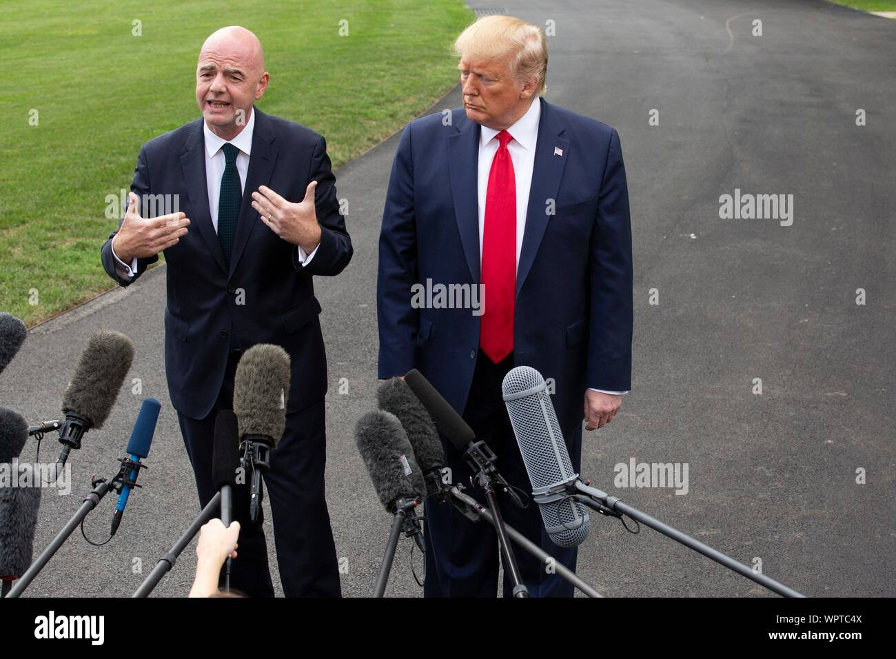 Washington, United States Of America. 09th Sep, 2019. United States President Donald J. Trump and the President of FIFA Gianni Infantino speak to the press as United States President Donald J. Trump departs the White House in Washington, DC, U.S. for a rally in North Carolina on September 9, 2019. Credit: Stefani Reynolds/CNP | usage worldwide Credit: dpa/Alamy Live News Stock Photo