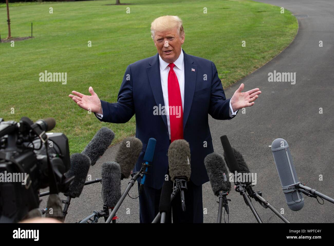 Washington, United States Of America. 09th Sep, 2019. United States President Donald J. Trump speaks to the press as he departs the White House in Washington, DC, U.S. for a rally in North Carolina on September 9, 2019. Credit: Stefani Reynolds/CNP | usage worldwide Credit: dpa/Alamy Live News Stock Photo