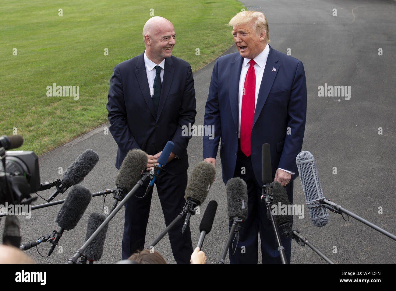 Washington, District of Columbia, USA. 9th Sep, 2019. United States President Donald J. Trump and the President of FIFA Gianni Infantino speak to the press as United States President Donald J. Trump departs the White House in Washington, DC, U.S. for a rally in North Carolina on September 9, 2019. Credit: Stefani Reynolds/CNP/ZUMA Wire/Alamy Live News Stock Photo