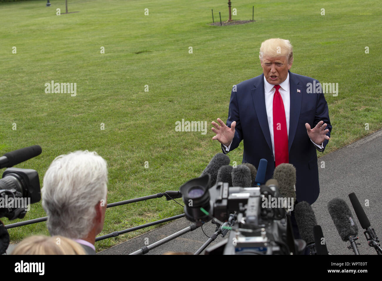 Washington, District of Columbia, USA. 9th Sep, 2019. United States President Donald J. Trump speaks to the press as he departs the White House in Washington, DC, U.S. for a rally in North Carolina on September 9, 2019. Credit: Stefani Reynolds/CNP/ZUMA Wire/Alamy Live News Stock Photo