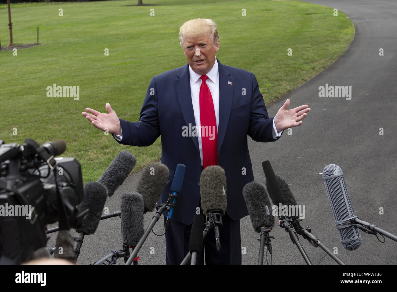 Washington, District of Columbia, USA. 9th Sep, 2019. United States President DONALD J. TRUMPspeaks to the press as he departs the White House in Washington, DC, U.S. for a rally in North Carolina. Trump announced peace talks with the Taliban 'are dead.' Credit: Stefani Reynolds/CNP/ZUMA Wire/Alamy Live News Stock Photo