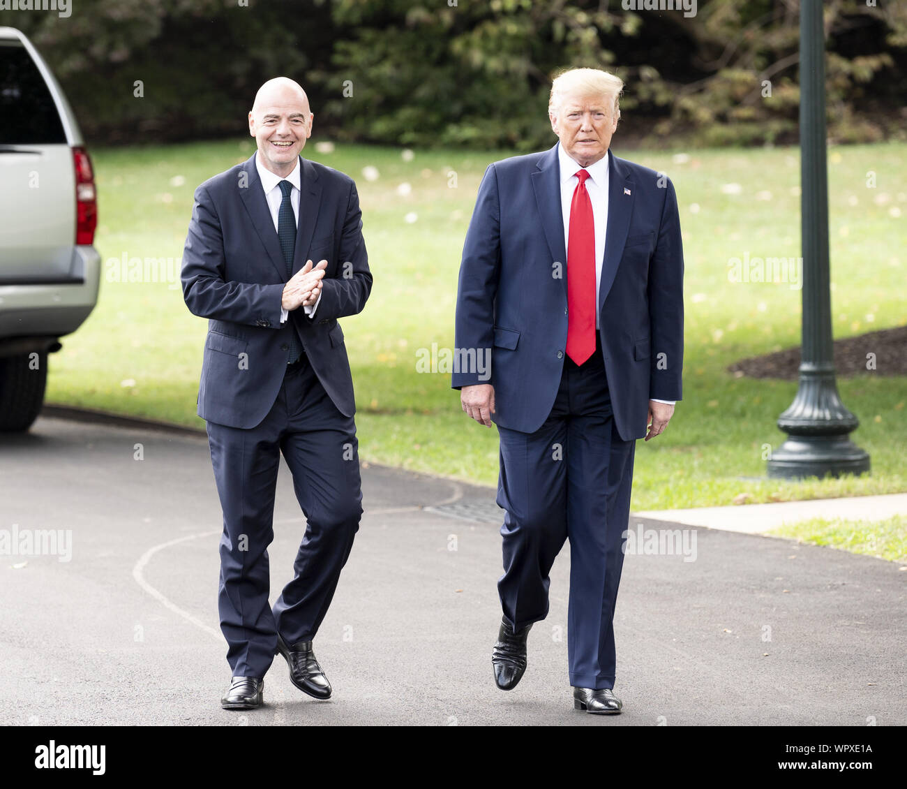 Washington, DC, USA. 9th Sep, 2019. September 9, 2019 - Washington, DC, United States: GIANNI INFANTINO, President of Federation International de Football Association (FIFA), and President DONALD TRUMP speaking with the press near the South Lawn of the White House as he leaves to go to a rally in North Carolina. Credit: Michael Brochstein/ZUMA Wire/Alamy Live News Stock Photo