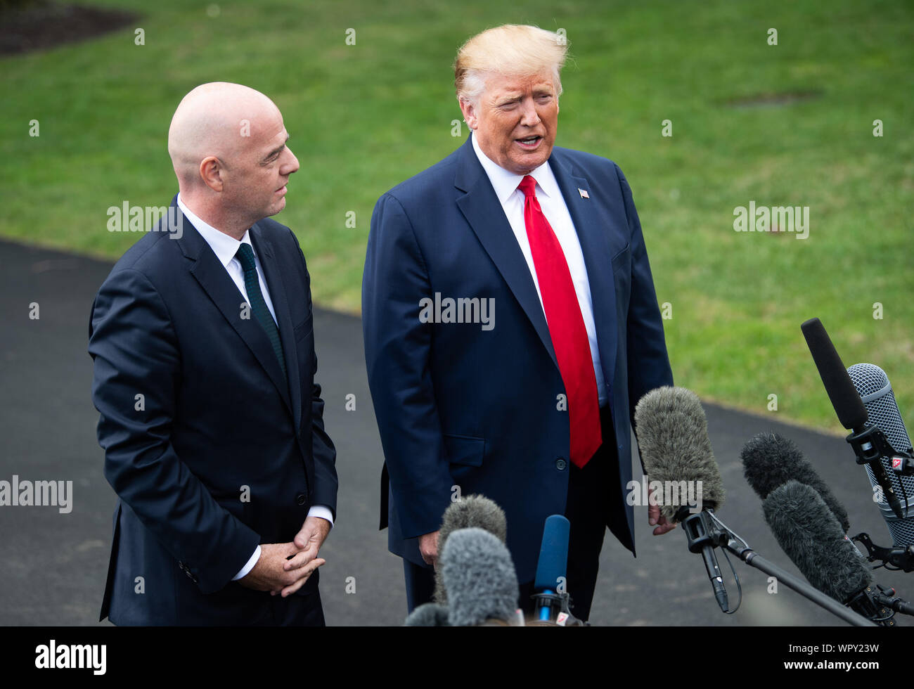 Washington DC, USA. 9th Sep 2019. President Donald Trump (R) and FIFA President Gianni Infantino speak to the media as Trump departs the White House for a rally in North Carolina, in Washington, DC on Monday, September 9, 2019. Photo by Kevin Dietsch/UPI Credit: UPI/Alamy Live News Stock Photo