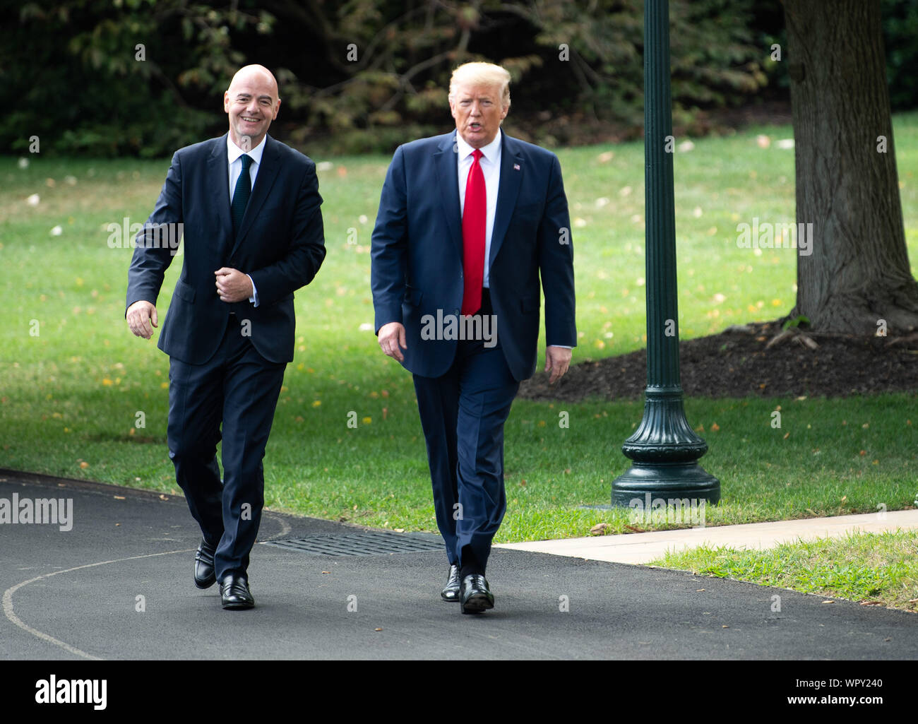 Washington DC, USA. 9th Sep 2019. President Donald Trump and FIFA President Gianni Infantino walk together as Trump departs the White House for a rally in North Carolina, in Washington, DC on Monday, September 9, 2019. Photo by Kevin Dietsch/UPI Credit: UPI/Alamy Live News Stock Photo