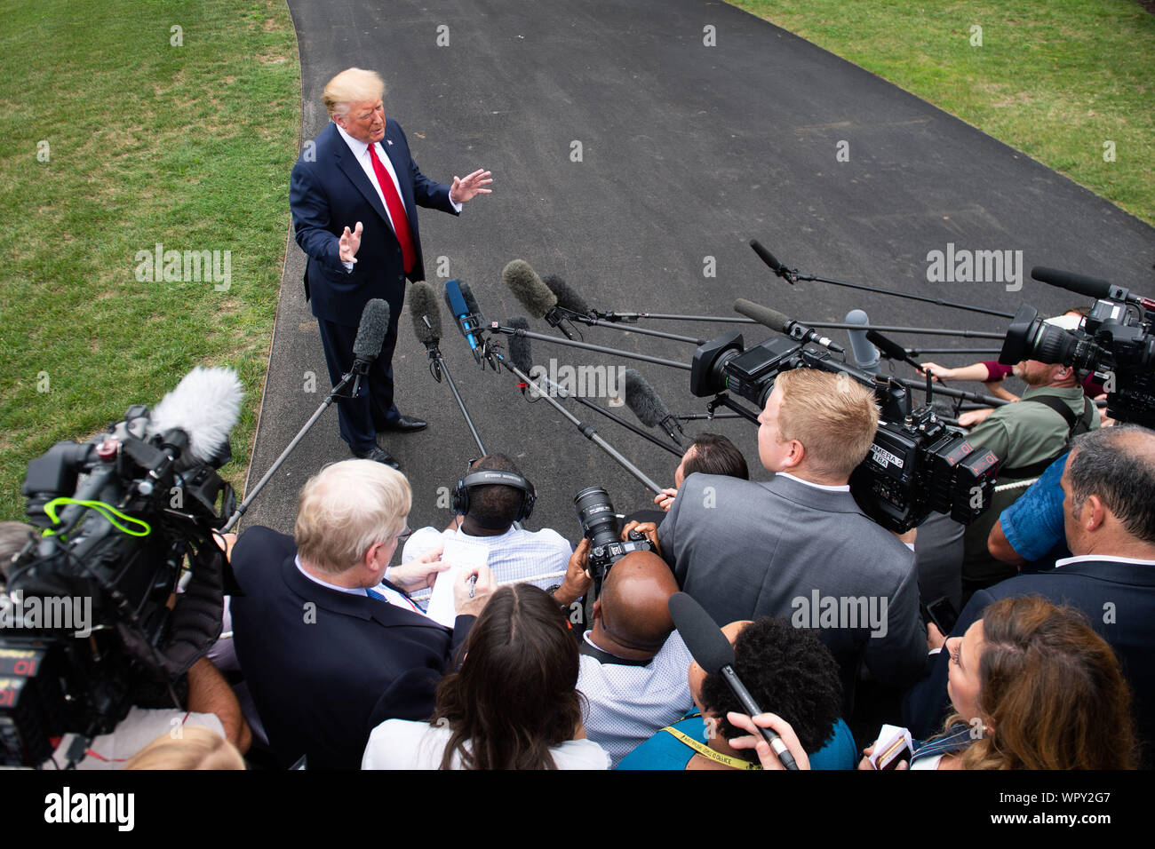 Washington DC, USA. 9th Sep 2019. President Donald Trump speaks to the media as he departs the White House for a rally in North Carolina, in Washington, DC on Monday, September 9, 2019. Photo by Kevin Dietsch/UPI Credit: UPI/Alamy Live News Stock Photo