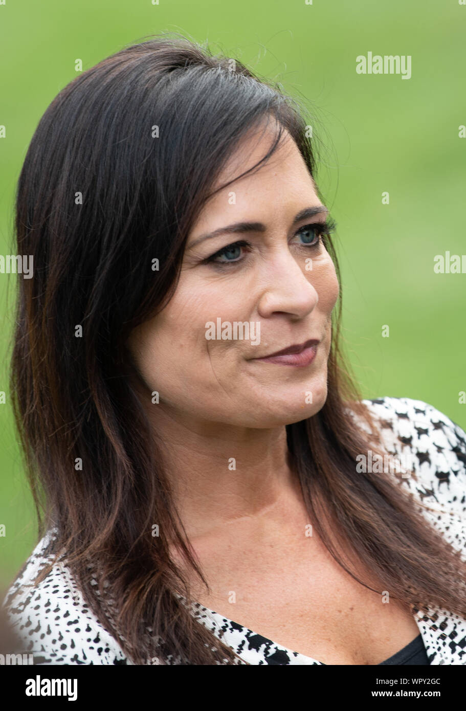 Washington DC, USA. 9th Sep 2019. White House Press Secretary Stephanie Grisham listens as President Donald Trump speaks to the media as he departs the White House for a rally in North Carolina, in Washington, DC on Monday, September 9, 2019. Photo by Kevin Dietsch/UPI Credit: UPI/Alamy Live News Stock Photo