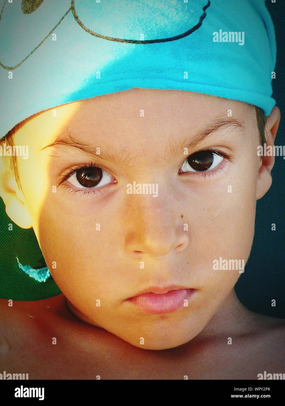 Close-up Portrait Of Cute Boy Stock Photo