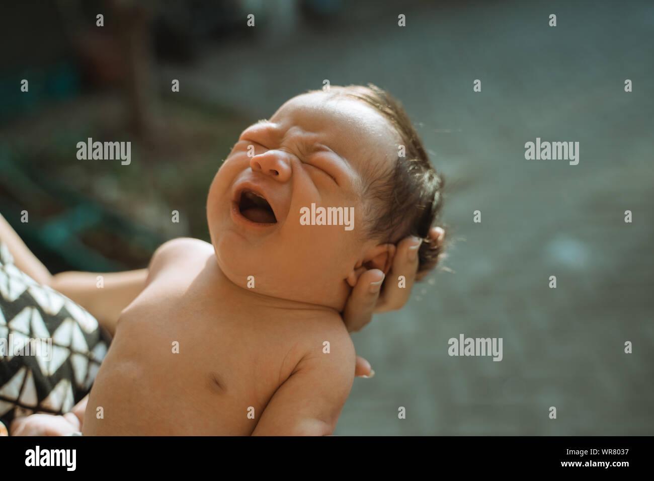 Cropped image of newborn sunbathing baby Stock Photo