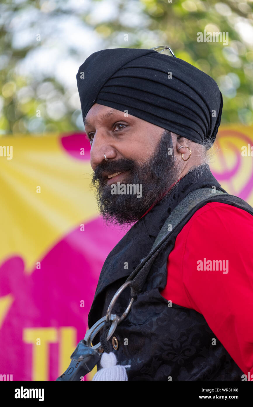 Drummer Jonny Kalsi from the Dhol Foundation playing at an annual concert of Jewish Klezmer music in Regent`s Park in London UK. Stock Photo