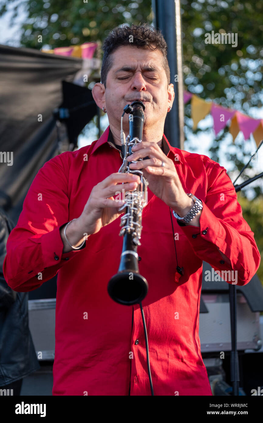 Talented clarinetist Merlin Shepherd playing at an annual concert of Jewish Klezmer music in Regent`s Park in London UK. Stock Photo