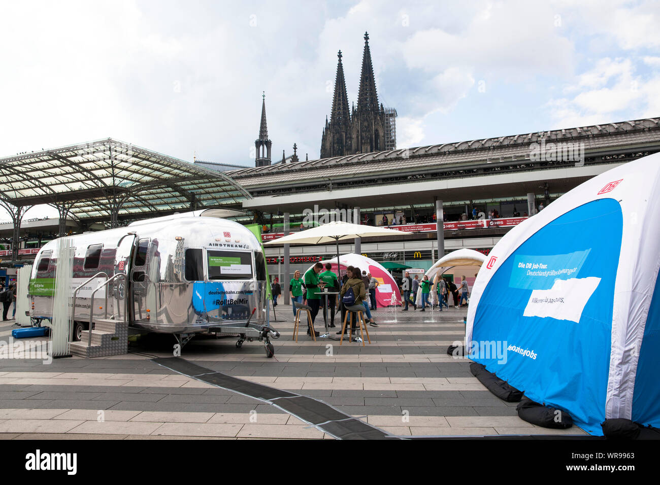 job exchange of Deutsche Bahn (German Railway) in front of the main station on Breslauer Platz, Cologne, Germany.  Jobboerse der Deutschen Bahn vor de Stock Photo