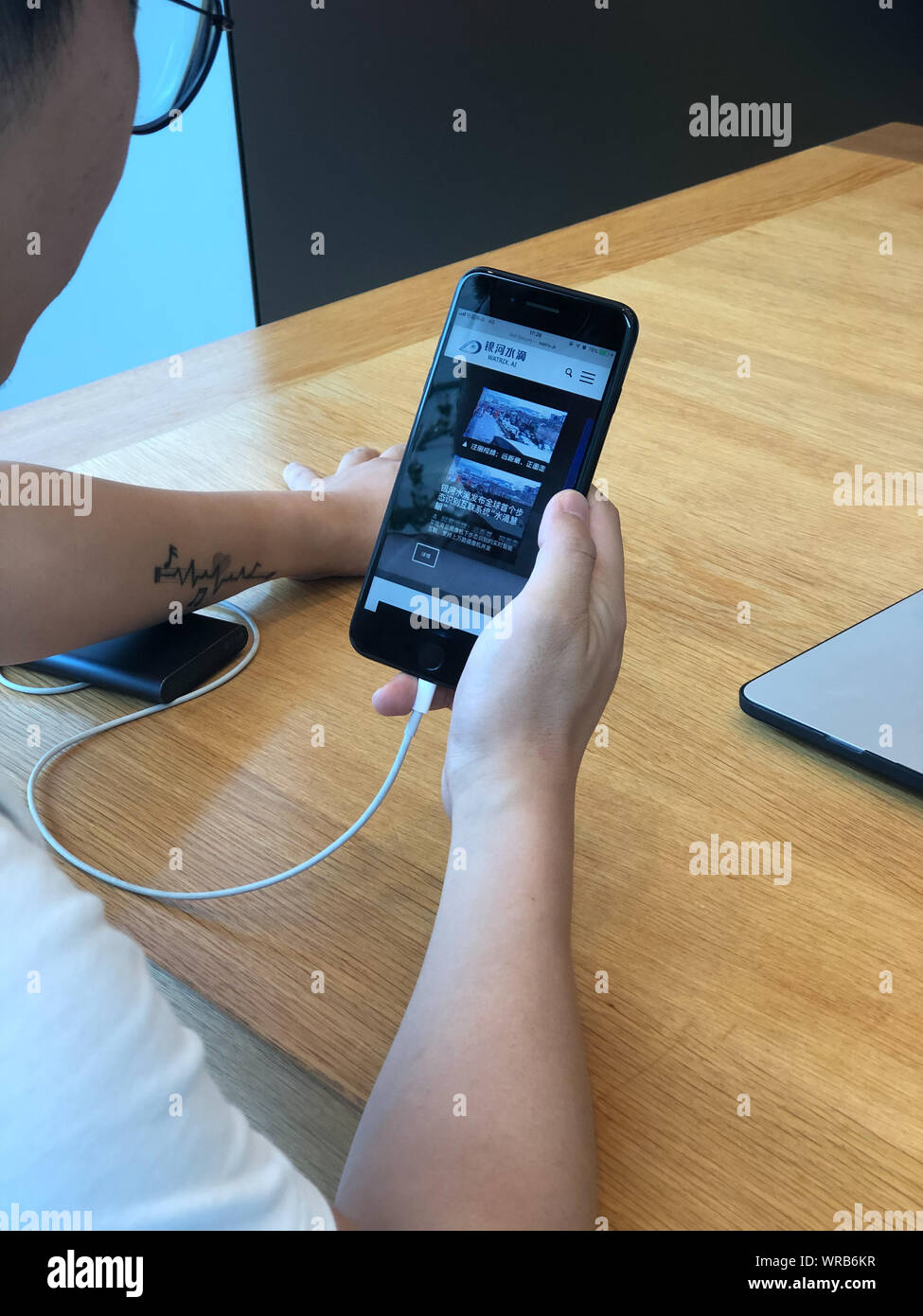 A Chinese netizen browses the website of AI technology company Watrix on his Apple iPhone smartphone in Beijing, China, July 23rd, 2019. Stock Photo