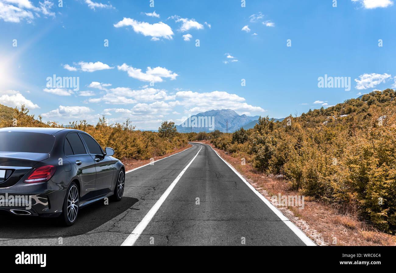 Car on the autumn road. Stock Photo