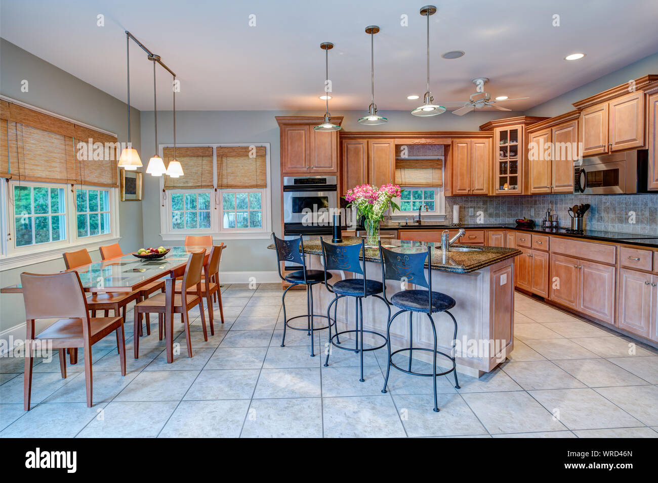 Open Concept Kitchen And Dining Room Combination With Windows Stock Photo Alamy