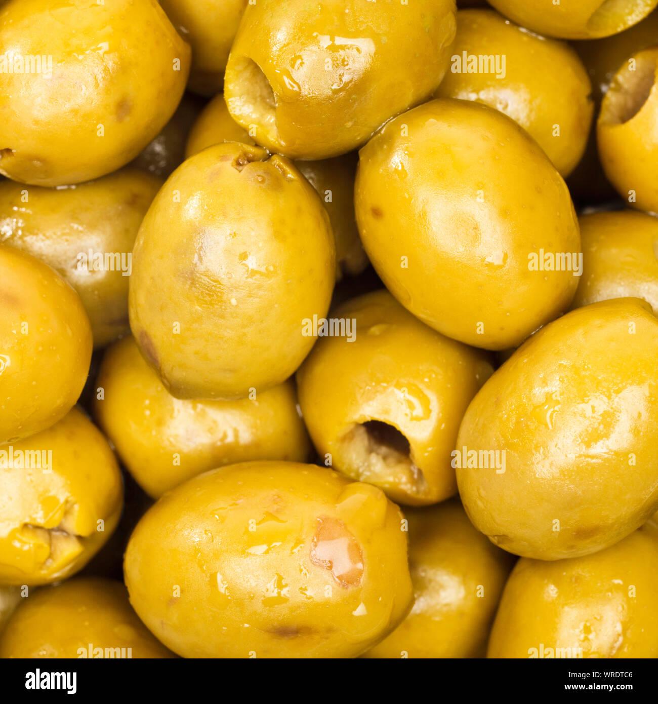 Fresh green olives, overhead view, close up Stock Photo