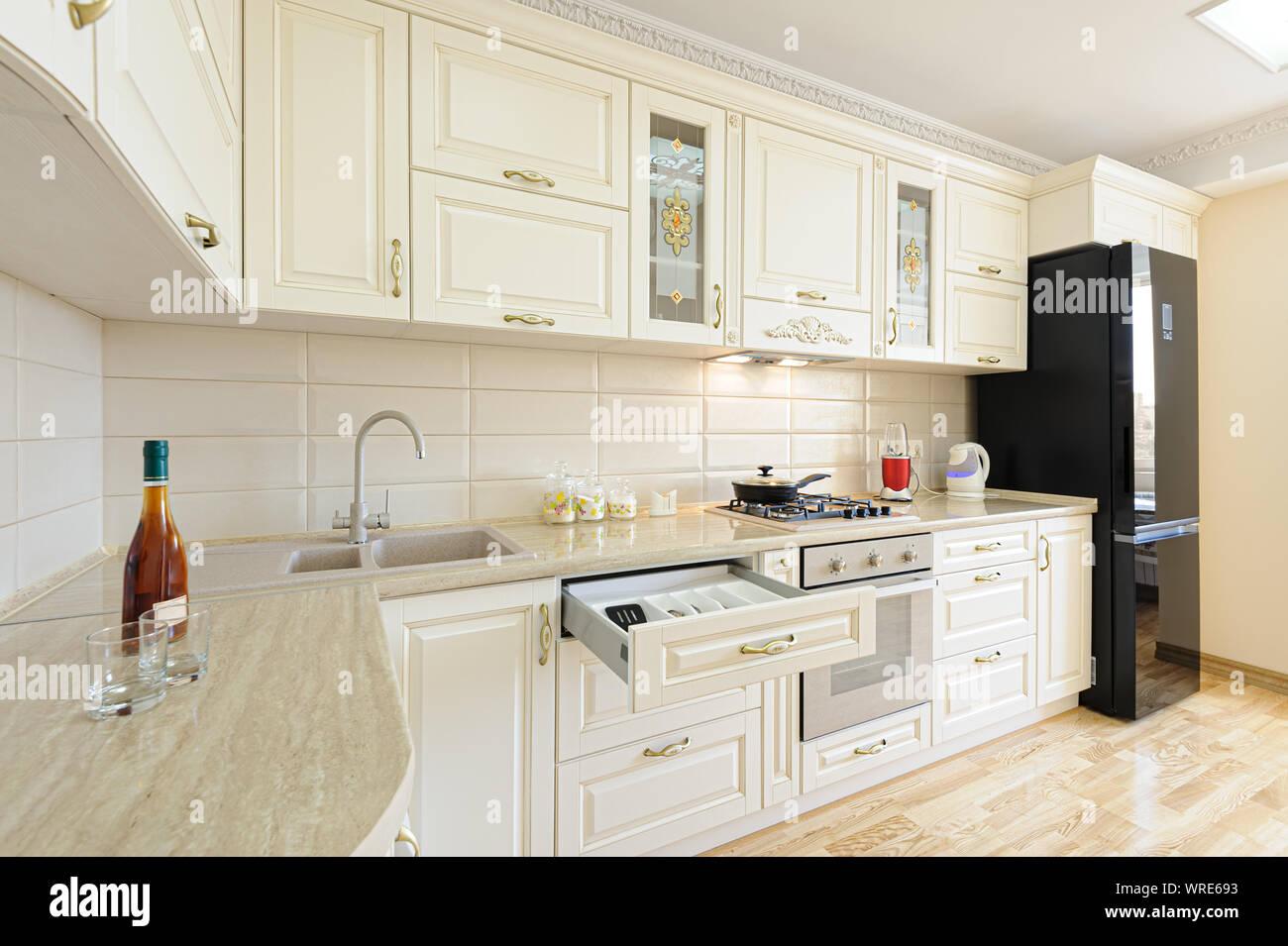 Luxury Modern Beige And White Kitchen Interior Stock Photo