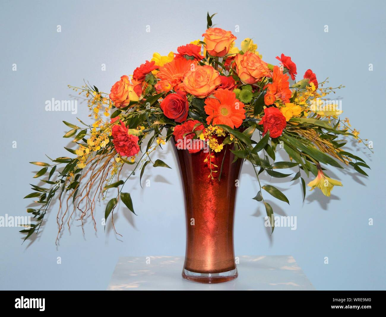 Lovely Autumn Floral Arrangement In A Tall Glass Vase Stock Photo Alamy