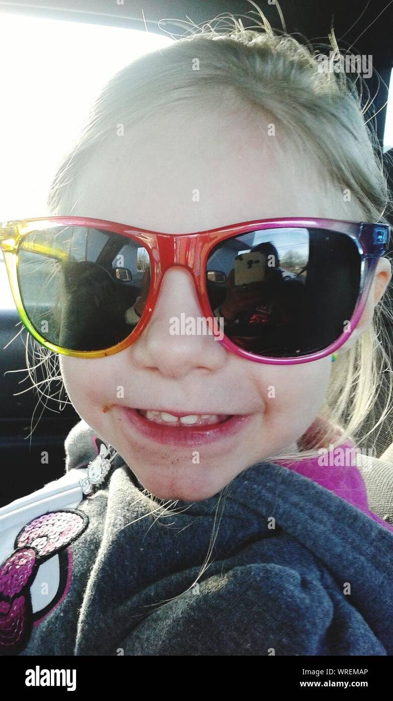 Close-up Of Girl Wearing Sunglasses In Car Stock Photo