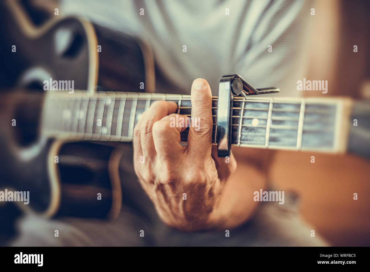 A man plays the guitar Stock Photo