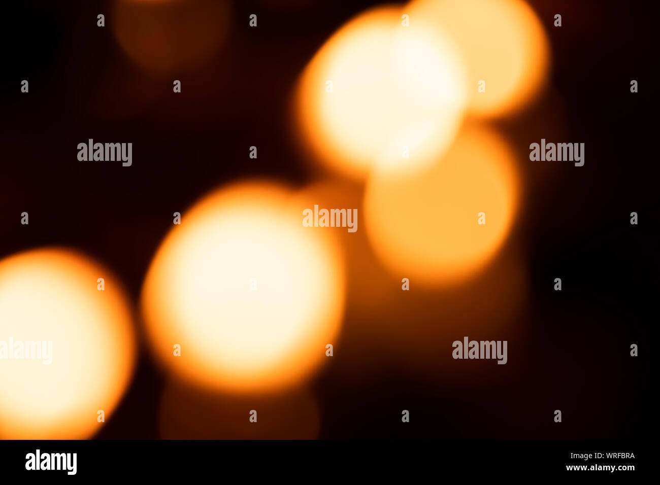 Light abstract bokeh background by blur or defocused at light element use for background or wallpaper in new year diwali christmas marriage celebratio Stock Photo