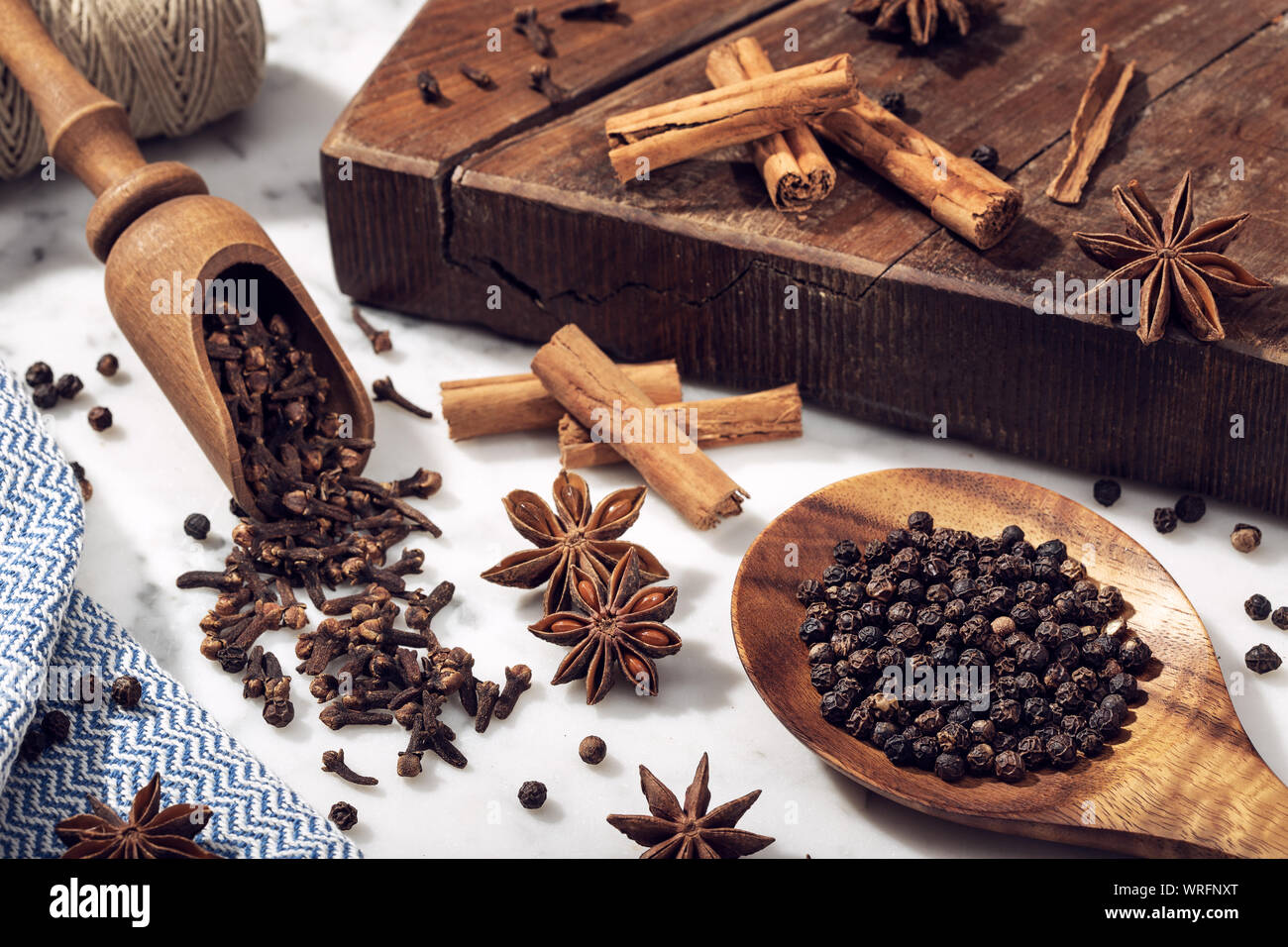 Set of spices on marble table. Star anise, cinnamon, clove and black pepper for cuisine Stock Photo