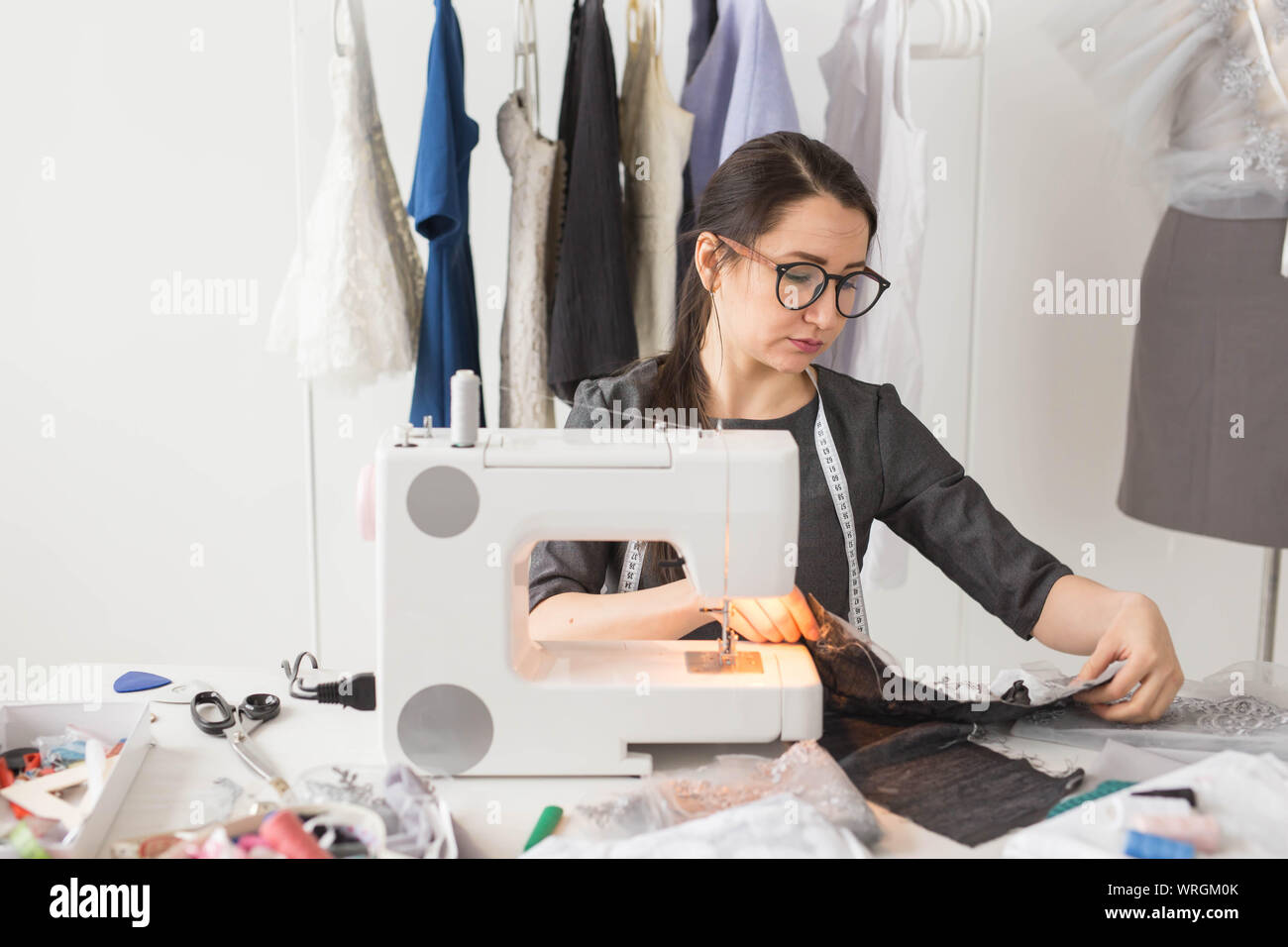 Dressmaker Fashion Tailor And People Concept Young Female Fashion Designer Working In Her Showroom Stock Photo Alamy