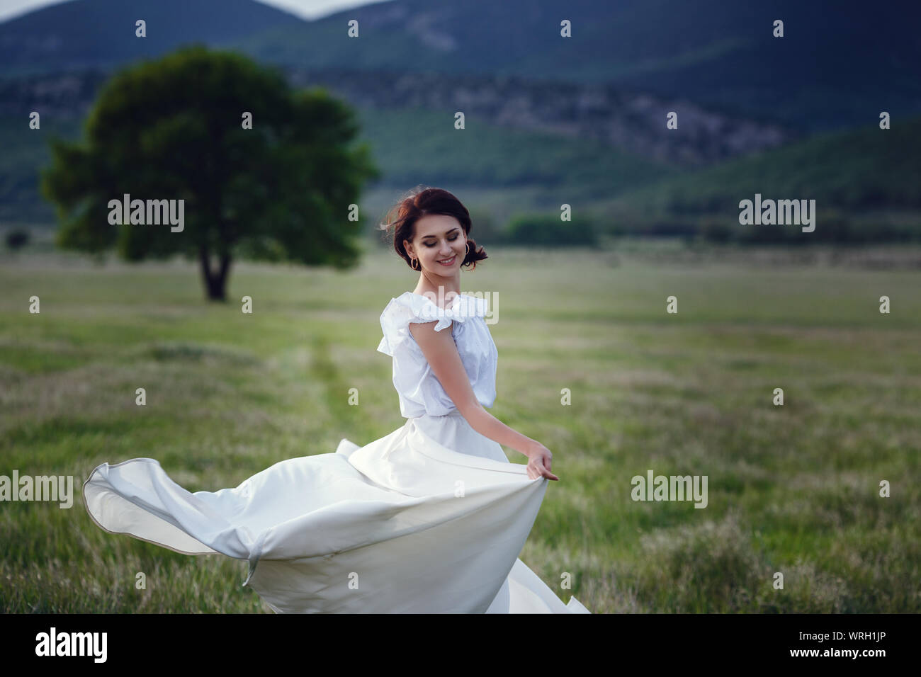 Woman Happy, Beautiful Active Free Girl on Summer Green Outdoor Background. Stock Photo