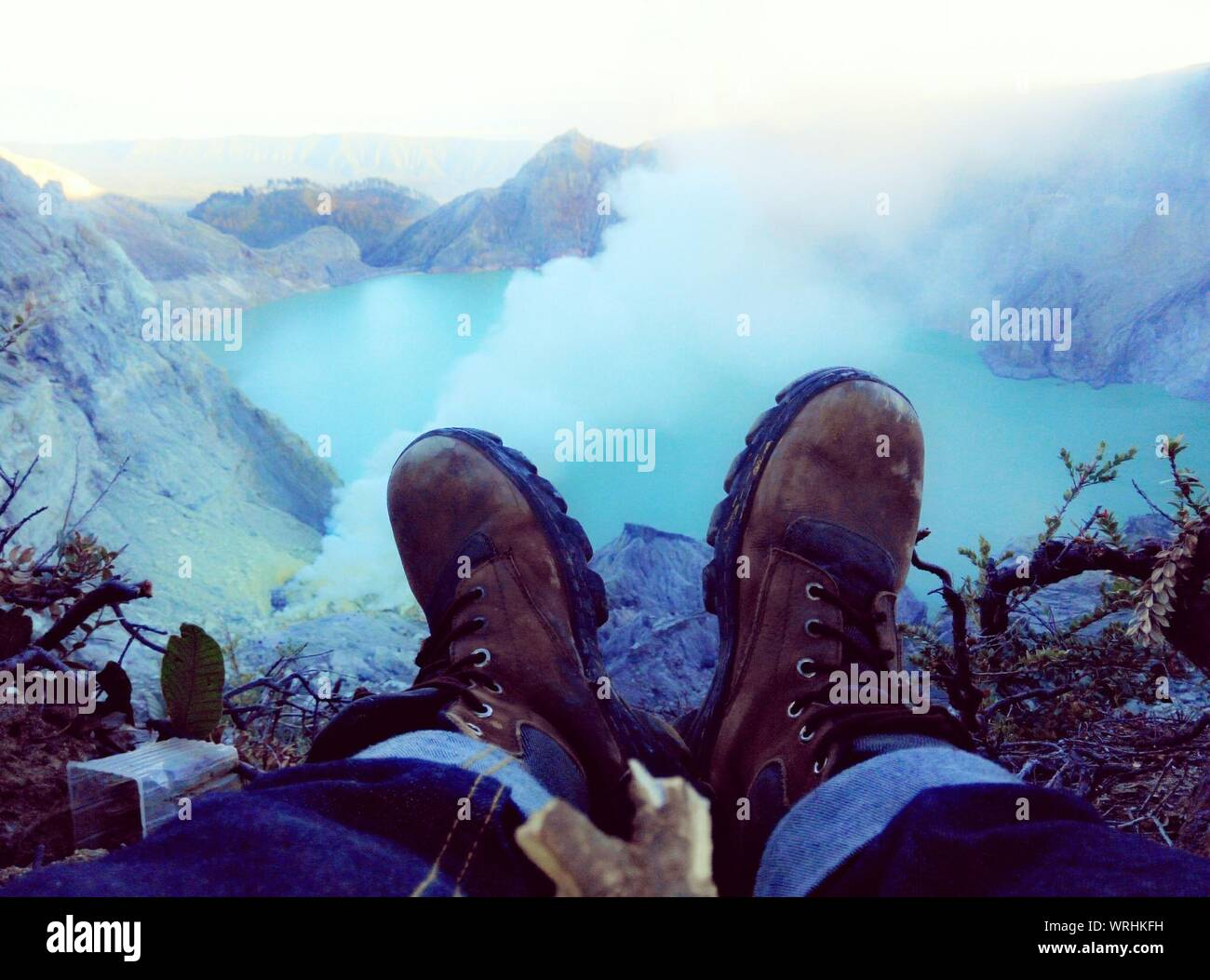 Avid Nature Lover Watching Hot Spring Valley In Wilds Stock Photo