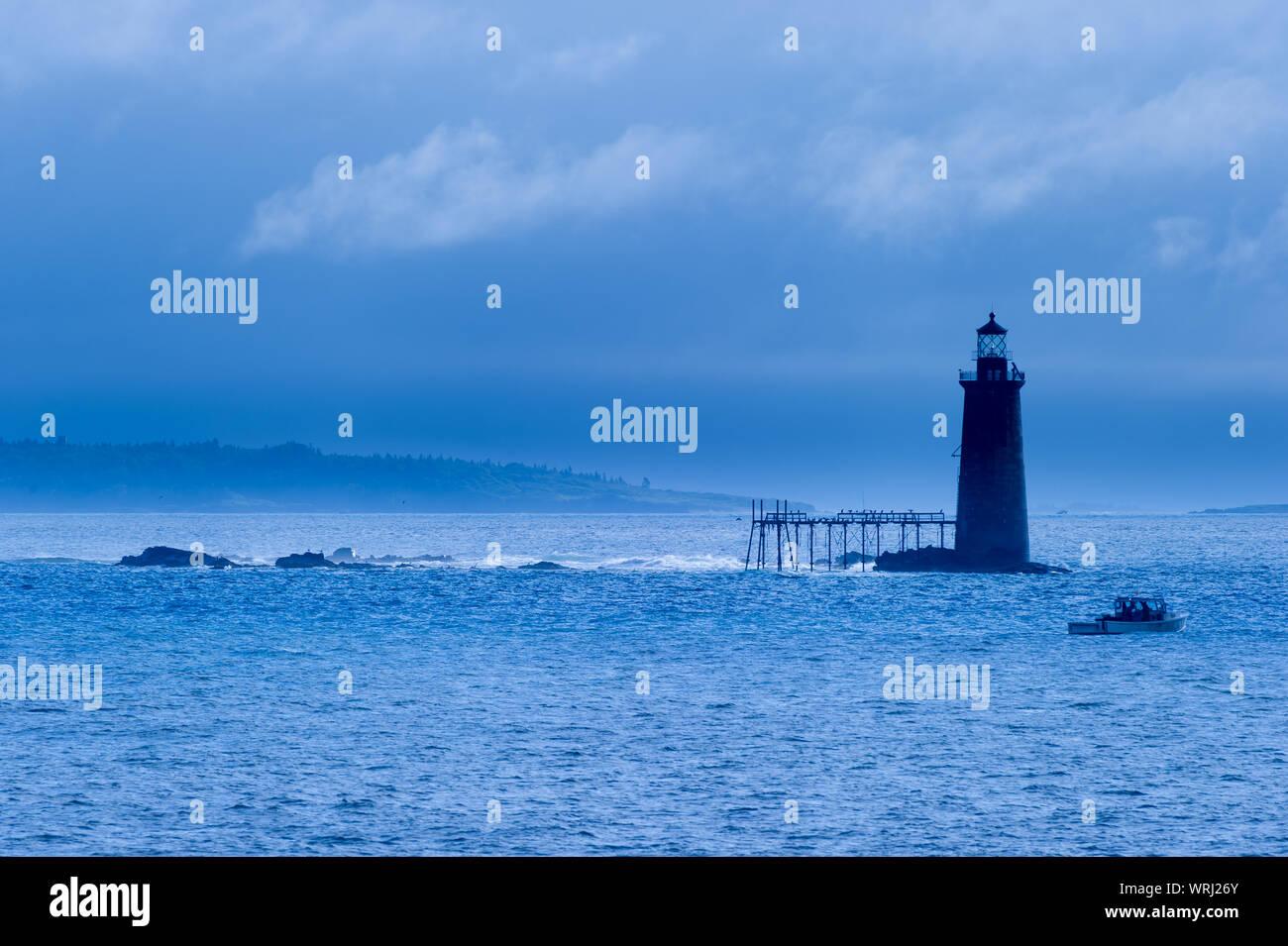 Fishing Boat Passing By Ram Island Ledge Lighthouse In Portland Maine Usa Stock Photo Alamy