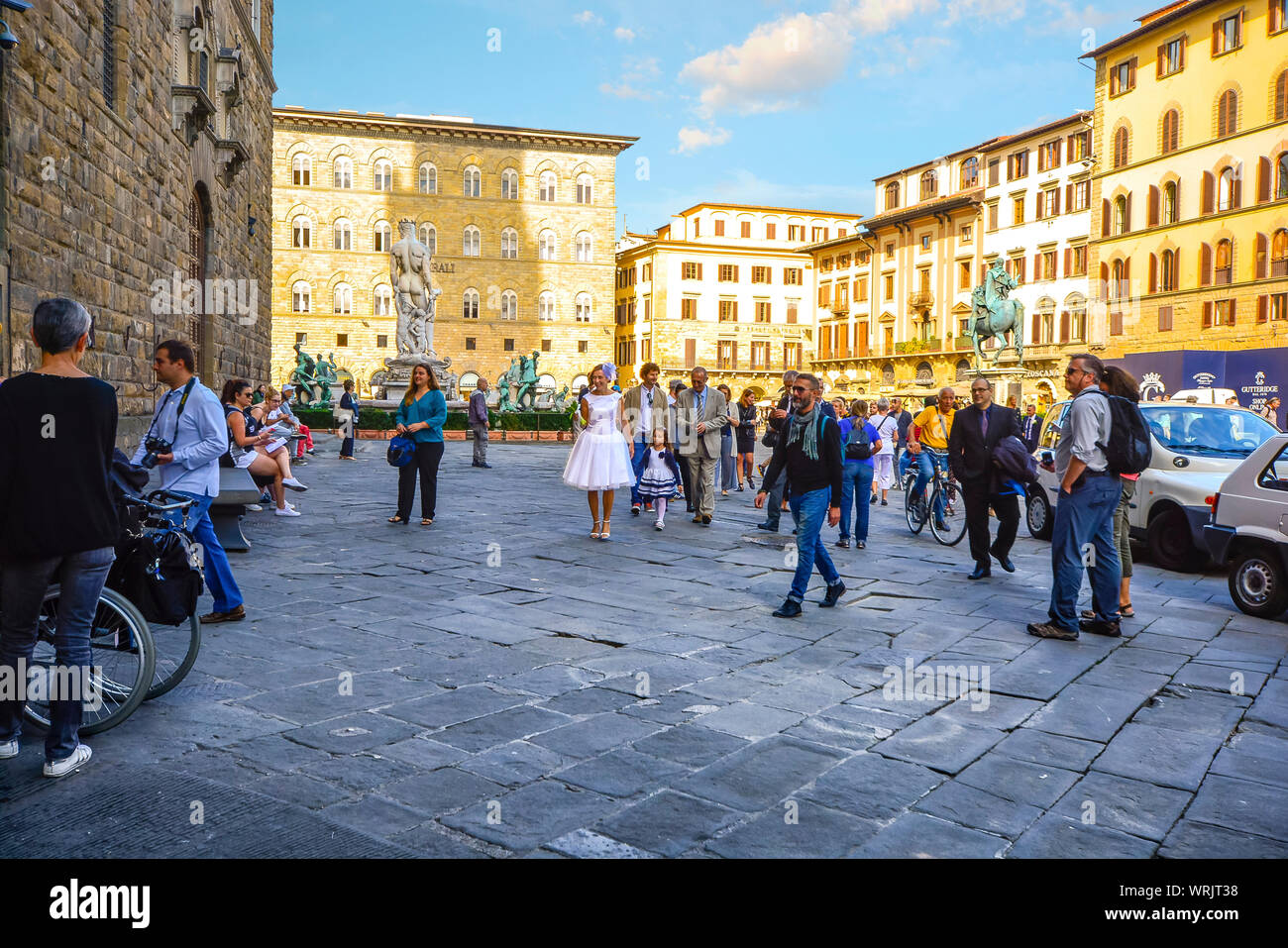 A bride and guests enter the Palazzo Vecchio in Florence Italy on the way to a wedding ceremony Stock Photo