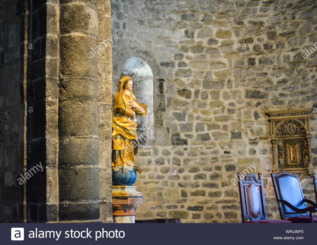 A statue of the Virgin Mary inside the Interior of Santa Margherita di Antiochia Church, in the Cinque Terre village of Vernazza, Liguria, Italy Stock Photo