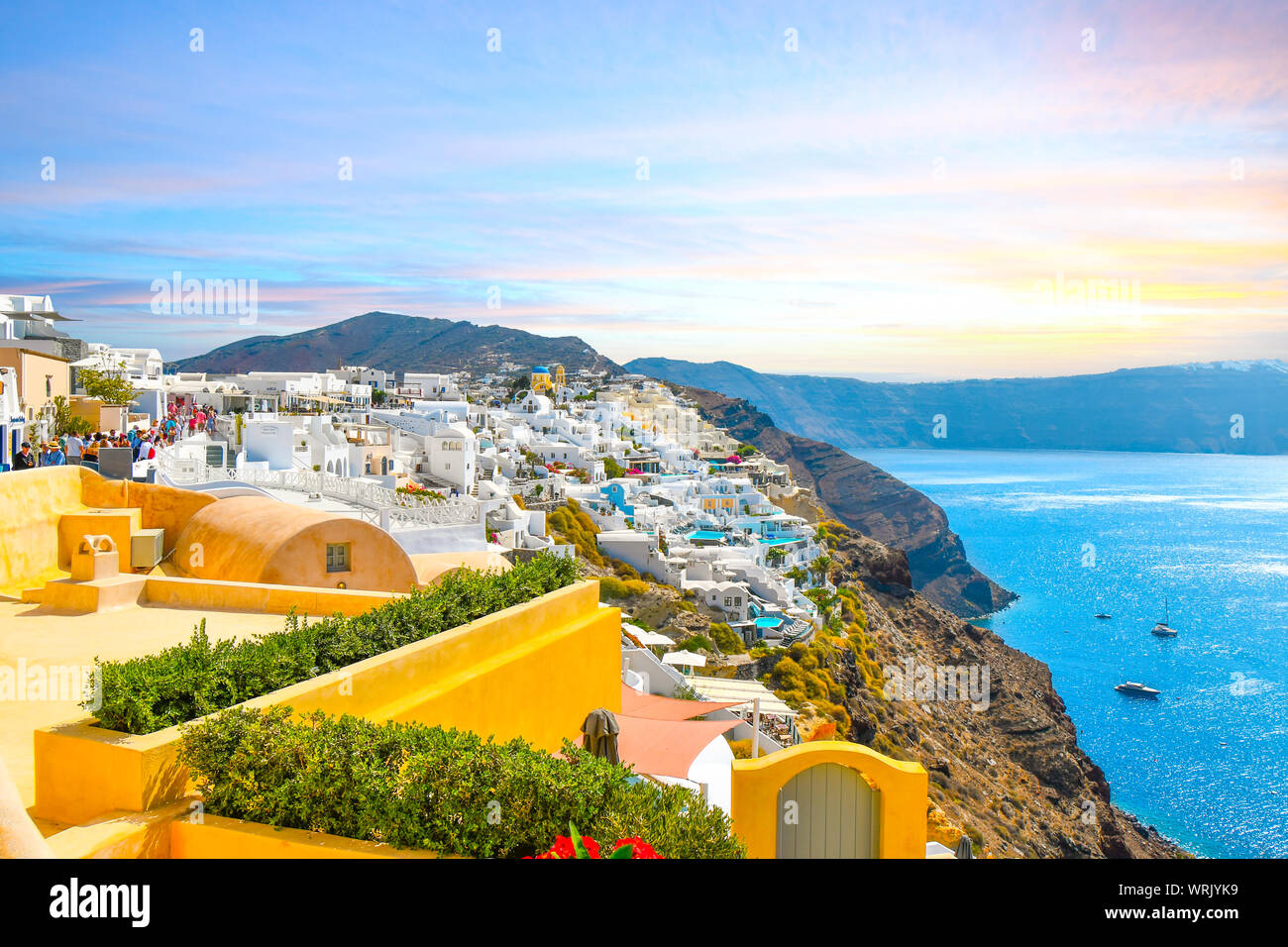 A picturesque scenic view of the Santorini caldera and the Aegean Sea from a resort terrace in the hillside village of Oia, Greece. Stock Photo